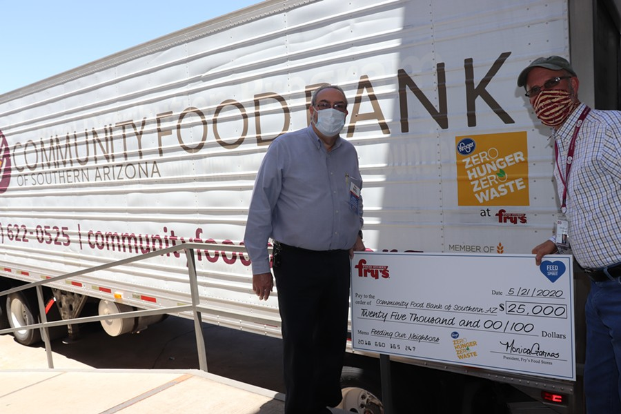 Mel Ryan, Fry's Food Stores Tucson District Manager (left) and Michael McDonald, CEO of the Community Food Bank of Southern Arizona (right) holding the $25,000 check.