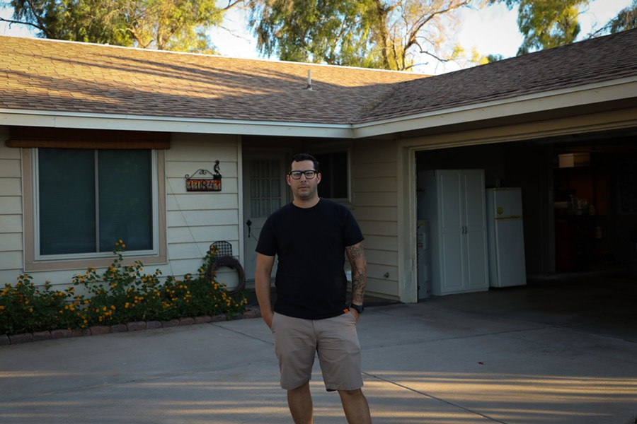 """Nick Dalton stands in the driveway of his mother's home in Ahwatukee Foothills, a few hundred yards from the April 11 shootout between Homeland Security Investigations agents and suspected human smuggler Warren Jose. """"Why would they do it here?"""" asked Dalton (Photo by Joel Farias Godinez/Howard Center)"""