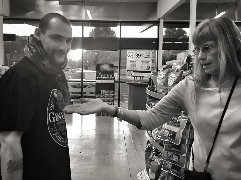 Sherman Ramsey, Satan's Little Helper and customer Debbie at Circle K. - BRIAN SMITH
