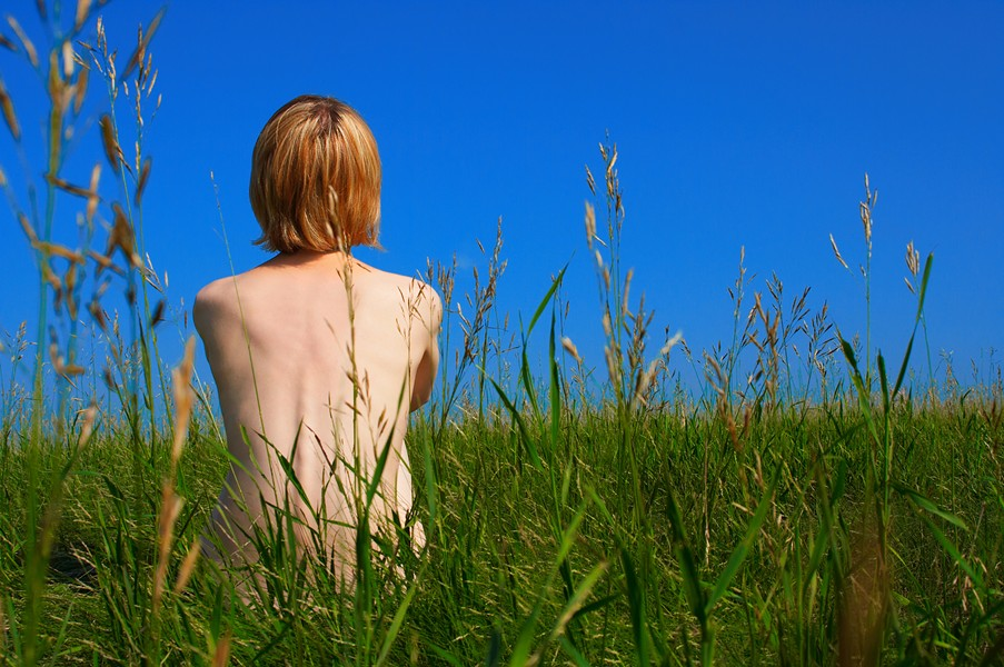 Just sitting in the tall grass, waiting for the end of allergy season. - BIGSTOCK
