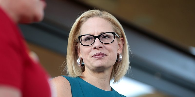 """Arizona Sen. Kyrsten Sinema, in a photo from 2018, is the rare Senate Democrat who has not gone on record against a GOP plan to move quickly on a replacement for Supreme Court Justice Ruth Bader Ginsburg. Political analysts see it as part of Sinema's effort to portray herself as a nonpartisan, but one Arizona Democrat calls it """"unacceptable."""""""