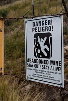 Fencing and danger signs like these near Dragoon, Arizona, are meant to keep people out of abandoned mines. A new Colorado-based Environmental Protection Agency office is supposed to track and help clean up abandoned mins in Western states.