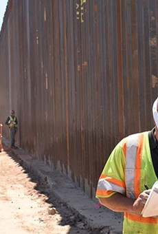 A U.S. Army Corps of Engineers contractor takes notes in May during work on the border wall near Yuma. Much of the funding for border wall construction this year was shifted from the Pentagon and other agencies' budgets, which has been challenged by the House of Representatives.