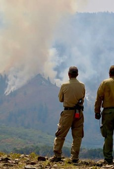 Firefighters watch a controlled burn within the Grizzly Creek Fire in Colorado. The fire has burned more than 30,000 acres near Glenwood Canyon. The charred hillsides pose a flood risk for nearby areas.
