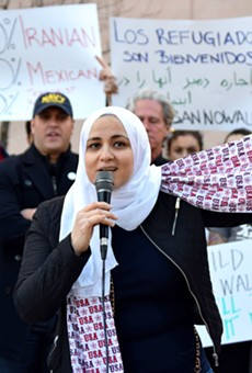 Oyla Labibieli speaks to the crowd at Tuesday's rally in support of refugees. Labibieli, who raised her children in the U.S., said Trump's ban is not inline with the values of the America she loves.