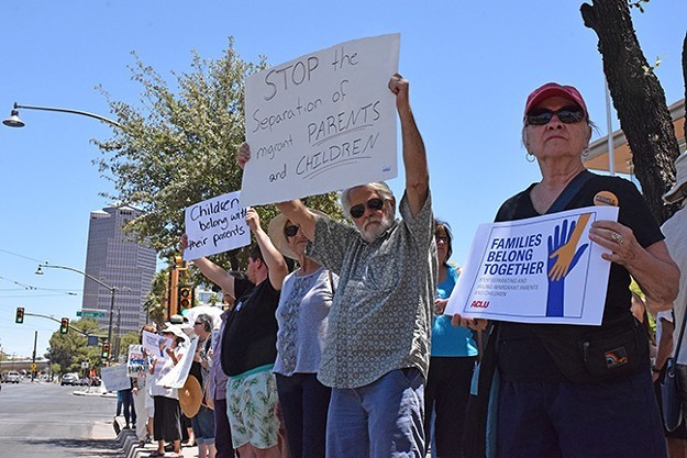 Tucsonans protest Trump's family separation policy, in June. - DANYELLE KHMARA