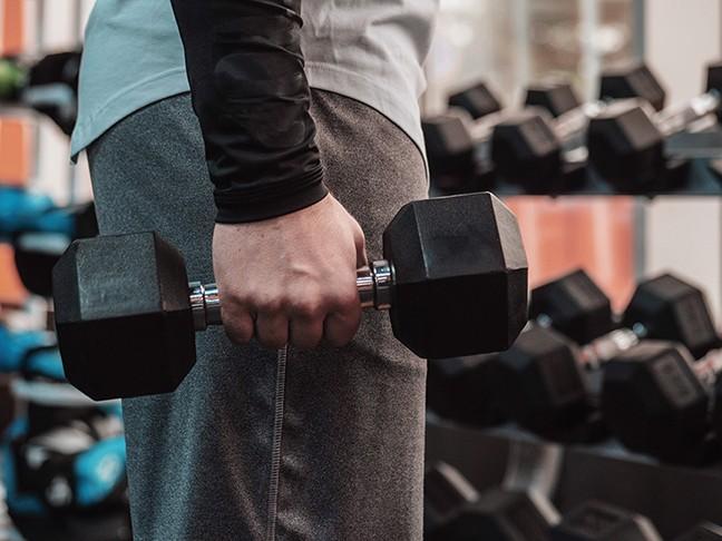 bigstock-powerful-bodybuilder-doing-the-239158477.jpg