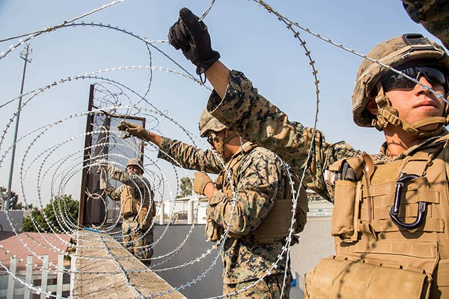 U.S. Marines with the 7th Engineer Support Battalion place concertina wire at the Otay Mesa Port of Entry in California on Nov. 11, as part of the deployment of thousands of active-duty troops to support border security efforts.