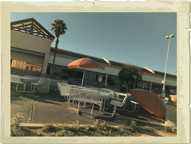 The remains of the Tanger Factory Outlet mall, now a decaying monument to highway capitalism. - COURTESY