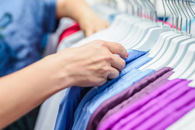 bigstock-hands-choose-a-lot-of-clothes--259266988.jpg