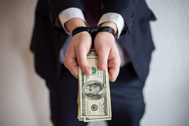 bigstock-bribe-and-corruption-offered--223405276.jpg