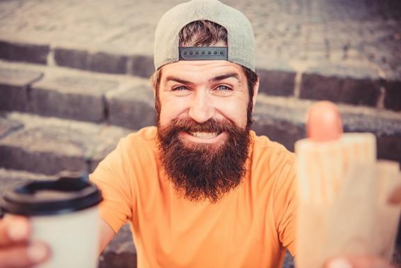 bigstock-man-bearded-eat-tasty-sausage--320820472.jpg