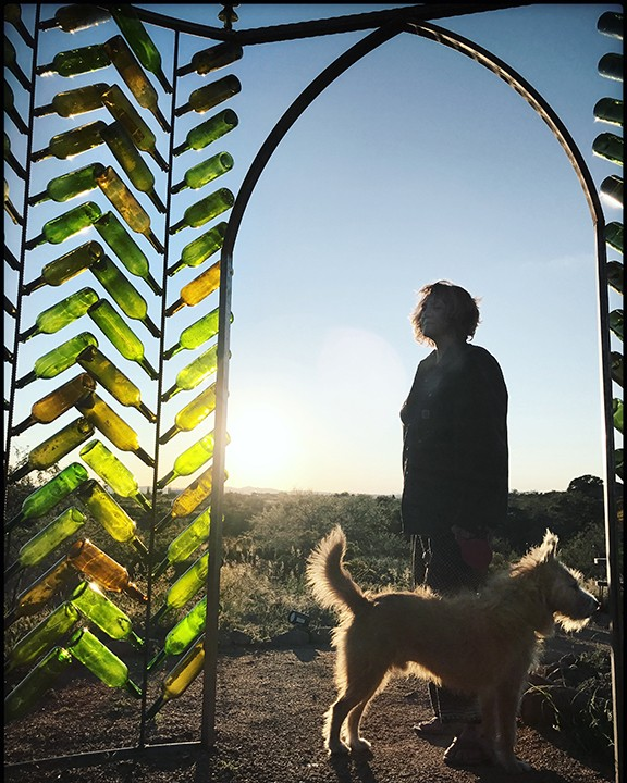 Sharon Holnback and her dog, Roscoe, at the Crystal Castle Installation created for 2018 GLOW!