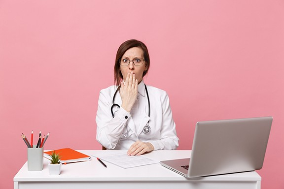 bigstock-tired-sad-female-doctor-sits-a-295727383.jpg