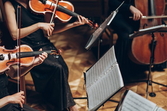 bigstock-elegant-string-quartet-playing-235267798.jpg
