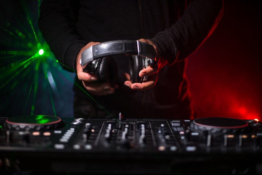 bigstock-dj-spinning-mixing-and-scrat-299427433.jpg