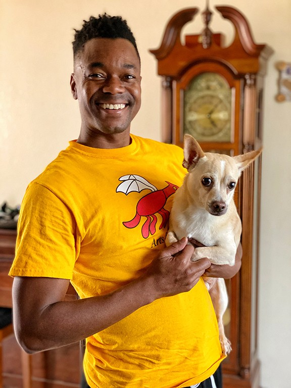Marquez Johnson and Buster at home.