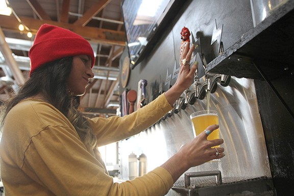 Violet Kasser pours a Keep Tucson Hoppy IPA, one of Thunder Canyon's most popular drafts.