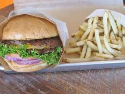 Graze double cheeseburger with a side of their fresh-cut Kennebec potatoes, fried Belgian style. Don't forget the dipping sauce! - TUCSON WEEKLY