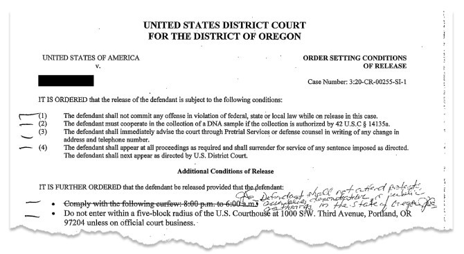 """Magistrate Judge John V. Acosta modified a court order to prohibit a Portland protester from attending """"protests, assemblies, demonstrations, or public gatherings in the state of Oregon."""" The defendant's name was redacted by ProPublica. (Obtained by ProPublica)"""