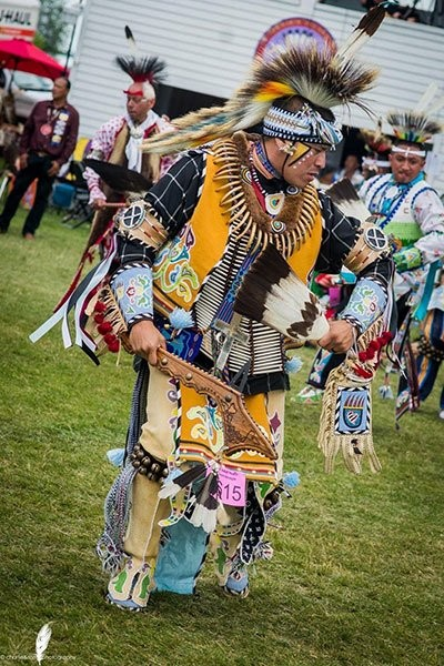 Juaquin Hamilton-YoungBird, historical ambassador for the Sac and Fox Nation and emcee for the Quarantine Dance Specials Facebook group, performs at a powwow on March 20, 2020. (Photo courtesy of Juaquin Hamilton-YoungBird)