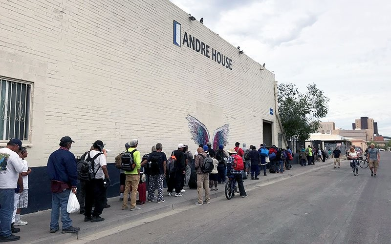 People wait in line for dinner at André House, a faith-based nonprofit that provides services to Arizonans experiencing homelessness or poverty. The number of families seeking help has almost doubled over the last month during the COVID-19 pandemic, according to a coordinator. - PHOTO COURTESY OF ELIZABETH WUNSCH/ANDRÉ HOUSE