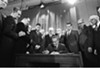 President Johnson signing Fair Housing Act into law.