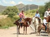 Cabalgatas (groups traveling on horseback) trek through the town of Imuris toward Magdalena, days before the feast of St. Francis Xavier.