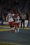 Offensive lineman Cody Creason, left, consoles running back JJ Taylor after he fumbled the football in the first half of Arizona's 31-30 loss to UCLA on Saturday night.