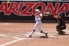 Arizona junior infielder Malia Martinez drives a pitch to left field during the Wildcats' 13-2 win over Stanford University on Saturday, April 20.