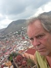 The author posing with the beautiful colonial city of Guanajuato below. (photo by DXS)