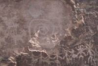 """Equinox """"sun dagger"""" on spiral petroglyph at Picture Rocks site, Pima County, Arizona - Uploaded by Old Pueblo Archaeology Center"""