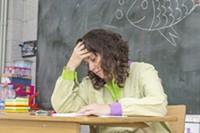 bigstock-tired-and-stressed-teacher-in--240167194.jpg
