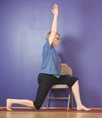 Nora Rankin guides attendees through easy chair yoga poses. - Uploaded by YogaConnection