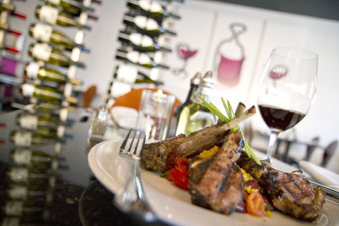 Zatar-crusted grilled New Zealand rack of lamb with saffron couscous and olive-tomato relish at Elle Wine Bistro.